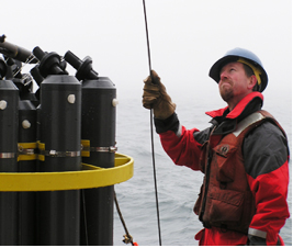 Dr. Christopher Sabine at work on a NOAA science vessel (NOAA 2010)